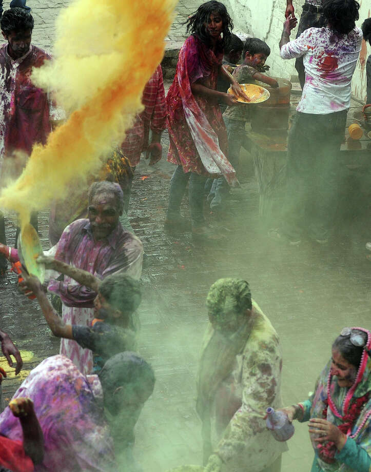 Pakistani Hindus throw colored powder during Holi celebrations in Lahore on March 27, 2013. Holi, or festival of colors, is a popular Hindu spring festival observed at the end of winter season on the last full moon day of the lunar month. Photo: ARIF ALI, AFP/Getty Images / 2013 AFP