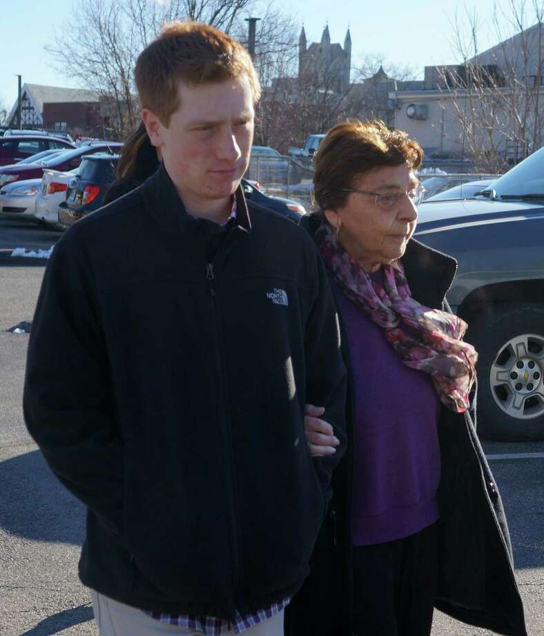 Estelle Margolis walks out of Norwalk Superior Court with her grandson, Jonah Newman, following a Jan. 18 hearing. She pleaded guilty Wednesday to a creating-a-public-disturbance charge related to her bringing a BB rifle and ammunition to a Jan. 8 Representative Town Meeting session. Photo: Paul Schott / Westport News