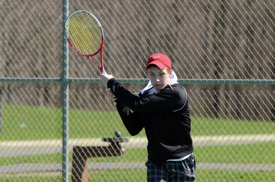 New Canaan's Will Burger warms up before a tennis match at New Canaan High School on Monday, Apr. 2, 2012. Photo: Amy Mortensen / Connecticut Post Freelance