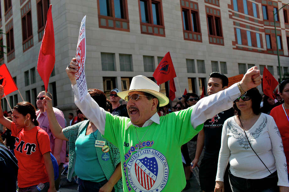 Al Esparza, President of LULAC in San Antonio, chants with marchers during the Cesar E. Chavez March for Justice in San Antonio on Saturday, March 31, 2012. Photo: Lisa Krantz, SAN ANTONIO EXPRESS-NEWS / SAN ANTONIO EXPRESS-NEWS
