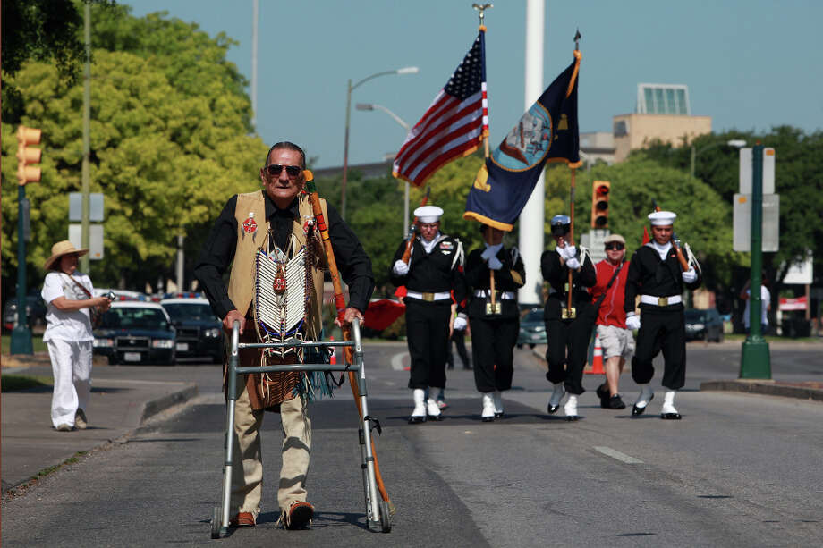 Jaime Brown Eagle, an Elder with the Iowa Apaches, walks on Cesar E. Chavez Blvd. during the Cesar E. Chavez March for Justice in San Antonio on Saturday, March 31, 2012. Photo: Lisa Krantz, SAN ANTONIO EXPRESS-NEWS / SAN ANTONIO EXPRESS-NEWS