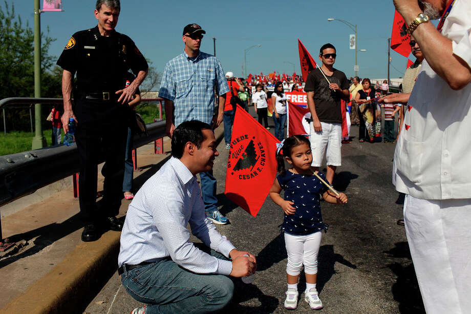 Mayor Julian Castro makes sure his daughter, Carina Castro, 3, stays hydrated during the Cesar E. Chavez March for Justice in San Antonio on Saturday, March 31, 2012. Photo: Lisa Krantz, SAN ANTONIO EXPRESS-NEWS / SAN ANTONIO EXPRESS-NEWS