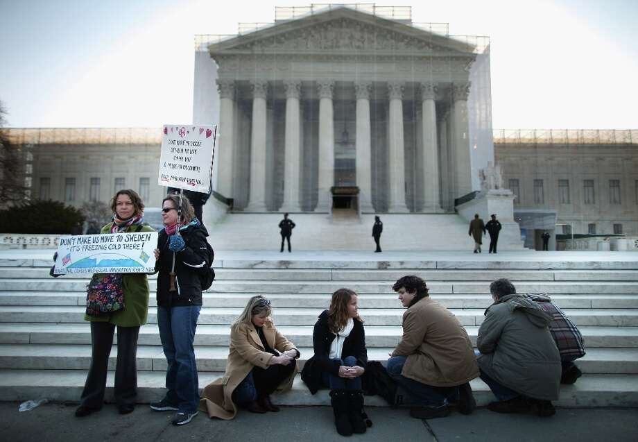 WASHINGTON, DC - MARCH 27:  People on both sides of the same-sex marriage issue, including (L-R) Anna Olsson and Michelle Bailey of Takoma Park, Maryland, near Sue Holland, Sam McWhorter and Patrick Wood of Gasden, Alabama, joining hundreds of other people outside the Supreme Court before oral arguments in a case challenging the Defense of Marriage Act March 27, 2013 in Washington, DC. The Supreme Court will hear arguments in the second case this week about same-sex marriage. Photo: Mark Wilson, Getty Images / 2013 Getty Images