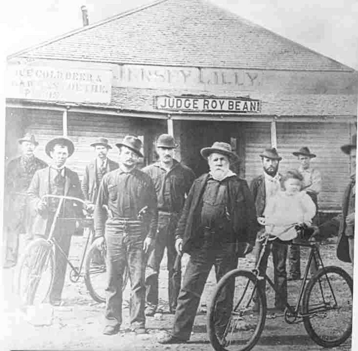 Judge Roy Bean and men posed in front of the Jersey Lilly. Photographed in Langtry, Tex