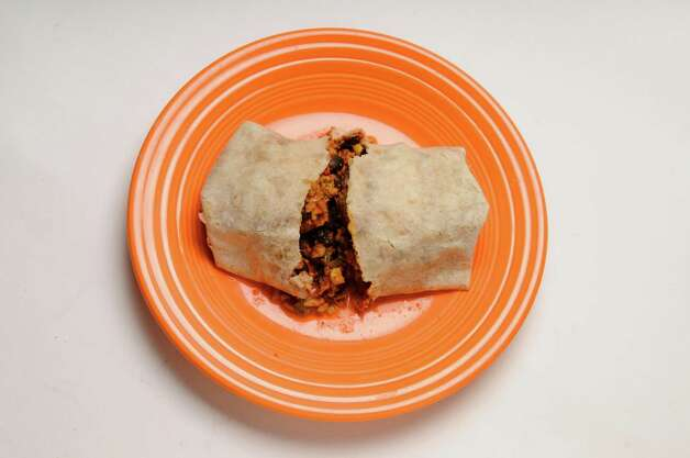 Red's bean and rice burrito Wednesday March 20, 2013, in Colonie, N.Y. (Will Waldron/Times Union) Photo: Will Waldron