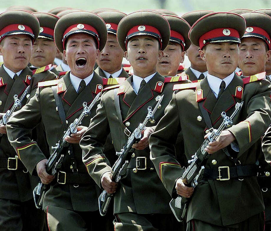 A North Korean military honor guard marches past during a welcome ceremony for European Council President and Swedish Prime Minister Goran Persson at Pyongyang airport, 02 May 2001.  Persson is leading a European Union delegation on a three-day visit to North Korea for talks aimed at helping the ailing peace process for the Korean peninsula. Photo: GREG BAKER, AFP/Getty Images / AFP