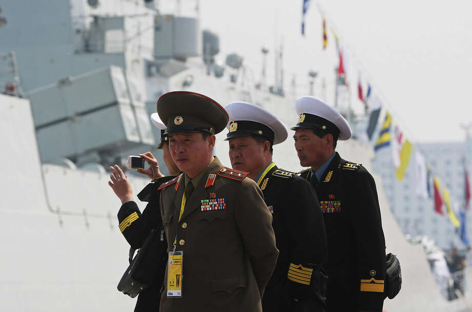 North Korean military officers look at China Navy Battleship of Wenzhou on April 22, 2009 in Qingdao, Shandong Province. The submarine will take part in an international fleet review to be held on April 23 to celebrate the 60th anniversary of the founding of the People's Liberation Army Navy. Photo: GUANG NIU, AFP/Getty Images / 2009 AFP