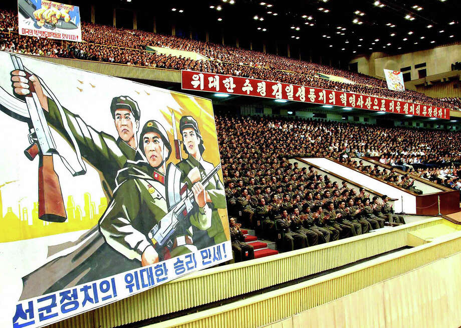 A picture released from North Korea's official Korean Central News Agency on May 27, 2009 shows North Korean military officers celebrating the second successful nuclear test at the Pyongyang Indoor Stadium on May 26, 2009, one day after North Korea staged an underground nuclear test. Photo: AFP, AFP/Getty Images / 2009 AFP