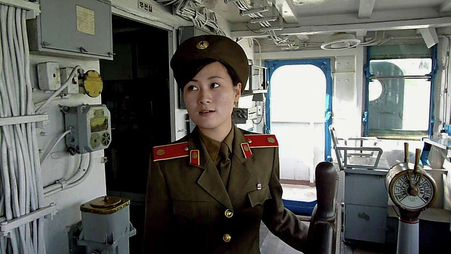 "This photo taken on September 22, 2010 shows a North Korean military female guide speaking to visitors at the commanding cabin inside the captured USS Pueblo docked at a port in Pyongyang. While North Korea denies involvement in a deadly attack on a South Korean warship this year, it proudly shows off the ""trophy"" it captured from the United States in another maritime incident 42 years ago, the USS Pueblo. Photo: AFP, AFP/Getty Images / 2010 AFP"