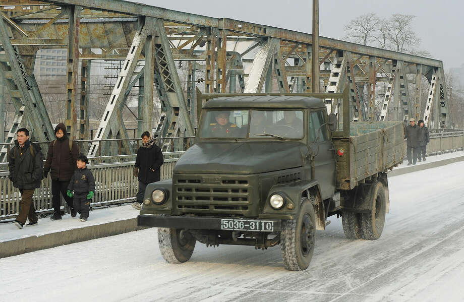 In this photo dated on February 26, 2008, a North Korean military truck drives over an old bridge in the North Korea capital, Pyongyang.  Former North Korean soldiers who defected to South Korea recently announced the creation of a new group aimed at toppling the communist regime in their homeland. The group, called the North Korean Veterans Association, led by former Lieutenant Colonel Sim Sin-Bok, is supported by about 1,300 former North Korean soldiers including 300 officers who have defected to South Korea in the past decade. Photo: MARK RALSTON, AFP/Getty Images / 2010 AFP