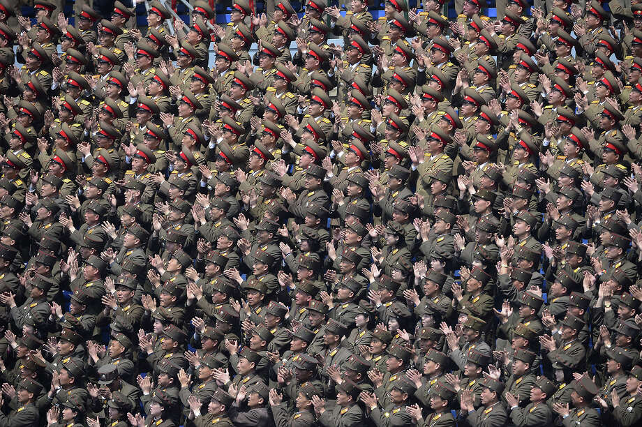 North Korean military applaud their leader Kim Jong-Un during a ceremony at a stadium in Pyongyang on April 14, 2012.  North Korea will mark the 100th birthday of their leader Kim Il-Sung on April 15. Photo: PEDRO UGARTE, AFP/Getty Images / 2012 AFP