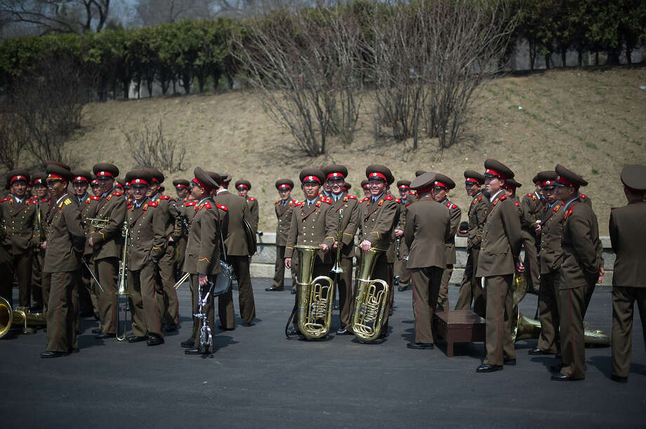 Members of a North Korean military band gather following an official ceremony at the Kim Il-Sung stadium in Pyongyang on April 14, 2012. Tens of thousands of people gathered in a football stadium on April 14 to shout support for North Korea's ruling dynasty, a day after a failed rocket launch seen as a major embarrassment for the regime. Photo: ED JONES, AFP/Getty Images / 2012 AFP