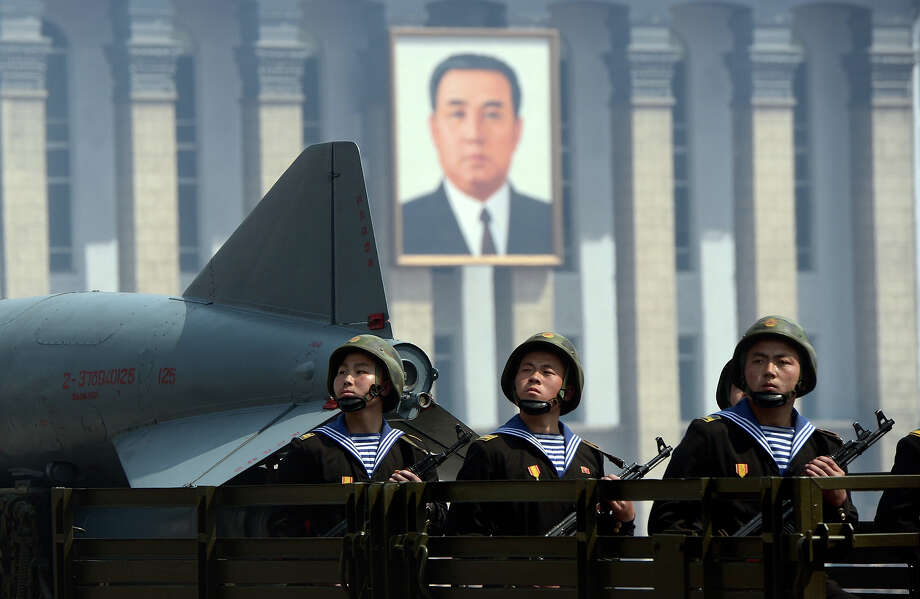 North Korean military ride on the back  of a truck  during a parade to mark 100 years since the birth of the country's founder Kim Il-Sung in Pyongyang on April 15, 2012. The commemorations came just two days after a satellite launch timed to mark the centenary fizzled out embarrassingly when the rocket apparently exploded within minutes of blastoff and plunged into the sea. Photo: PEDRO UGARTE, AFP/Getty Images / 2012 AFP