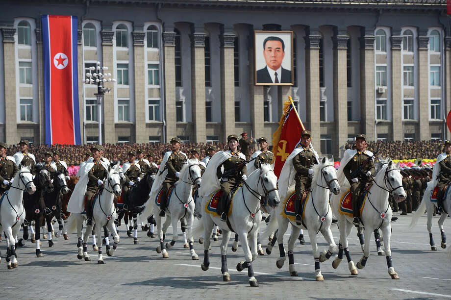 North Korean military ride horses as they take part in a parade to mark 100 years since the birth of the country's founder Kim Il-Sung in Pyongyang on April 15, 2012. The commemorations came just two days after a satellite launch timed to mark the centenary fizzled out embarrassingly when the rocket apparently exploded within minutes of blastoff and plunged into the sea. Photo: PEDRO UGARTE, AFP/Getty Images / 2012 AFP