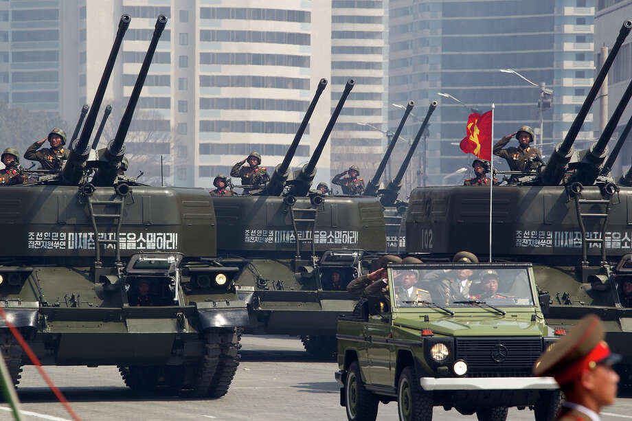 North Korean military vehicles take part in a parade to mark 100 years since the birth of the country's founder Kim Il-Sung in Pyongyang on April 15, 2012.  The commemorations came just two days after a satellite launch timed to mark the centenary fizzled out embarrassingly when the rocket apparently exploded within minutes of blastoff and plunged into the sea. Photo: ED JONES, AFP/Getty Images / 2012 AFP