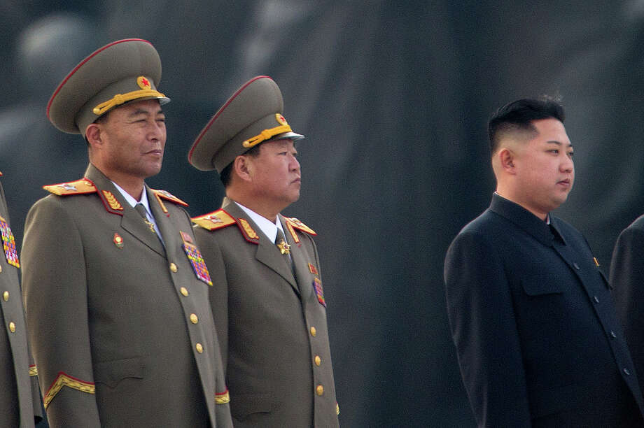This photo taken on April 13, 2012 shows North Korean military chief Ri Yong-Ho (L) and North Korean leader Kin Jong-Un (R) at a ceremony in Pyongyang. North Korea's army chief Ri Yong-Ho has been relieved of all his posts due to illness, state media said on July 16, 2012, in a surprise development that removes one of new leader Kim Jong-Un's inner circle. Photo: ED JONES, AFP/Getty Images / 2012 AFP