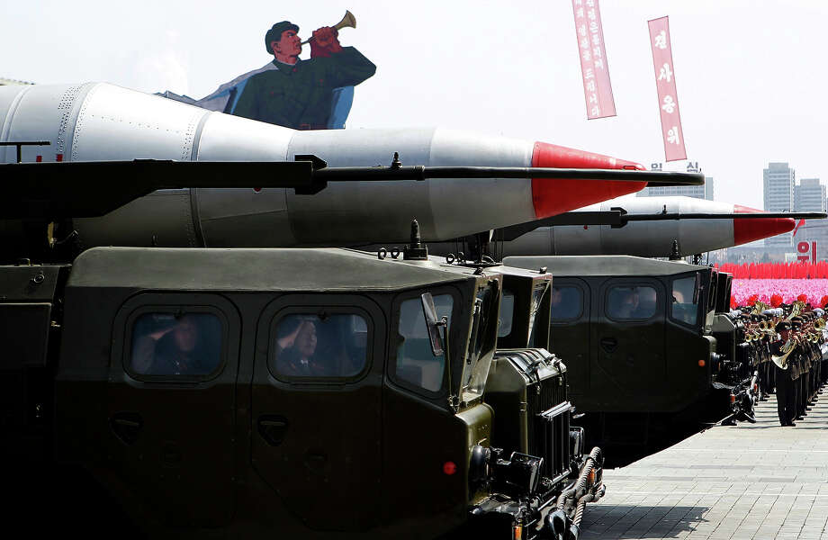 North Korean military rockets are transported in a mass military parade in Pyongyang's Kim Il Sung Square to celebrate 100 years since the birth of North Korean founder, Kim Il Sung on Sunday, April 15, 2012. Photo: Ng Han Guan, ASSOCIATED PRESS / AP2012