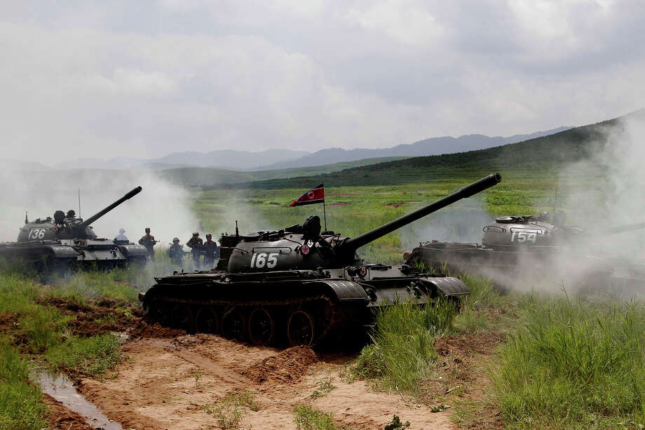 North Korean soldiers from the historic 105 tank unit move during a military exercise at an undisclosed location in North Korea Friday, July 27, 2012, marking the 59th anniversary of the armistice that ended the 1950-53 Korean War. The 105 tank unit, which denounced joint U.S. and South Korean military exercises, is named after North Korean military officer Ryu Kyong Su, honored by North Korea for his role leading troops during the Korean War. Photo: Jon Chol Jin, ASSOCIATED PRESS / AP2012