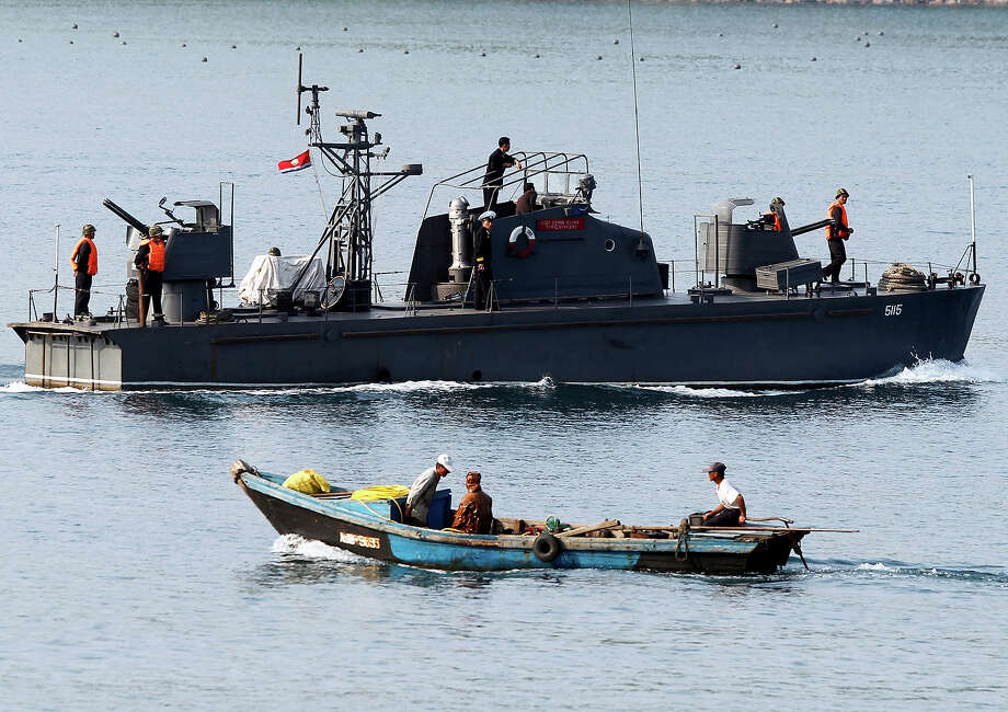 In this photo taken Thursday, Sept. 1, 2011, a North Korean fishing boat moves past a North Korean military vessel guiding a North Korean leisure boat, unseen, out of the bay area of the Kumgang mountain resort in North Korea. Photo: Ng Han Guan, ASSOCIATED PRESS / AP2011