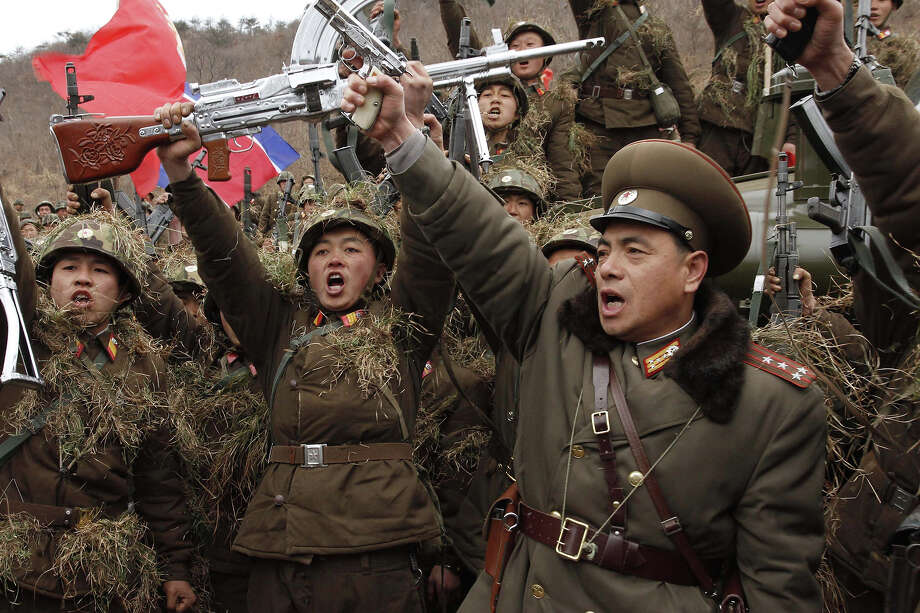 North Korean soldiers chant denunciations of South Korean President Lee Myung-bak at a North Korean military base on North Korea's southwest coast, opposite South Korea's Baengnyeong Island Monday, March 5, 2012. Photo: Kim Kwang Hyon, ASSOCIATED PRESS / AP2012