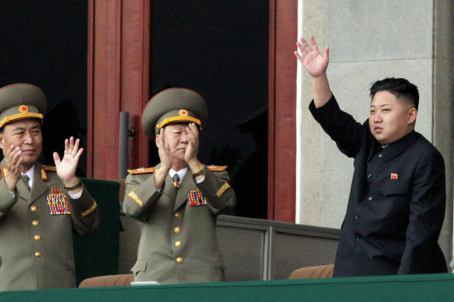 North Korean leader Kim Jong Un, right, waves as North Korean military officers clap during a mass meeting of North Korea's ruling party at a stadium in Pyongyang, North Korea on Saturday April 14, 2012. North Korea will mark the 100-year birth anniversary of the late leader Kim Il Sung on Sunday, April 15. Photo: Ng Han Guan, ASSOCIATED PRESS / AP2012