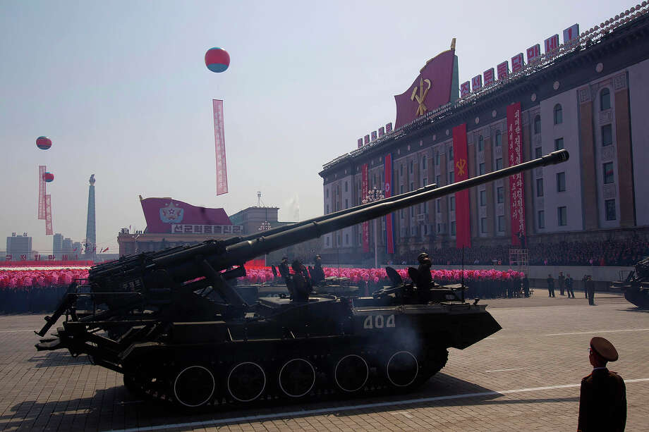 North Korean military vehicles pass by during a mass military parade in Pyongyang's Kim Il Sung Square to celebrate 100 years since the birth of the late North Korean founder Kim Il Sung on Sunday, April 15, 2012. Photo: David Guttenfelder, ASSOCIATED PRESS / AP2012