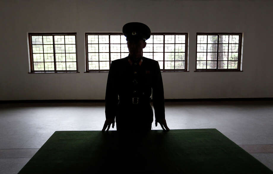"A North Korean military officer talks the history at a museum hall at Demilitarized Zone that separates the two Koreas in Panmunjom, North Korea Monday, April 23, 2012. North Korea promised Monday to reduce South Korea's conservative government ""to ashes"" in less than four minutes, in an unusually specific escalation of recent threats aimed at its southern rival.  The statement by North Korea's military, carried by state media, comes amid rising tensions on the Korean peninsula. Both Koreas recently unveiled new missiles, and the North unsuccessfully launched a long-range rocket earlier this month. Photo: Vincent Yu, ASSOCIATED PRESS / AP2012"