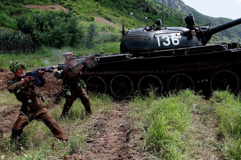 North Korean soldiers from the historic 105 tank unit fire during a military exercise at an undisclosed location in North Korea Friday, July 27, 2012, marking the 59th anniversary of the armistice that ended the 1950-53 Korean War. The 105 tank unit, which denounced joint U.S. and South Korean military exercises, is named after North Korean military officer Ryu Kyong Su, honored by North Korea for his role leading troops during the Korean War. Photo: Jon Chol Jin, ASSOCIATED PRESS / AP2012