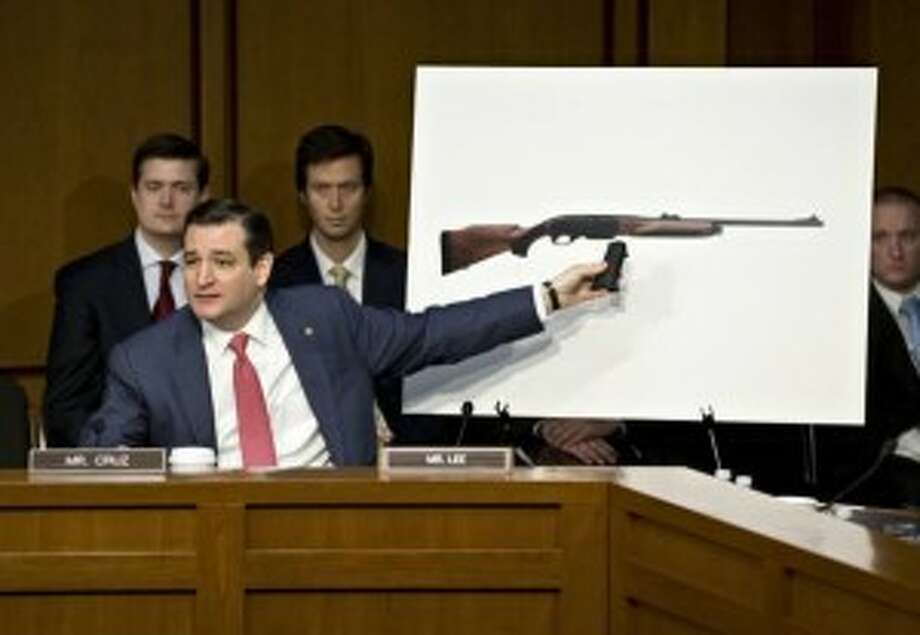 Ted Cruz uses props to illustrate his opposition to gun control laws.