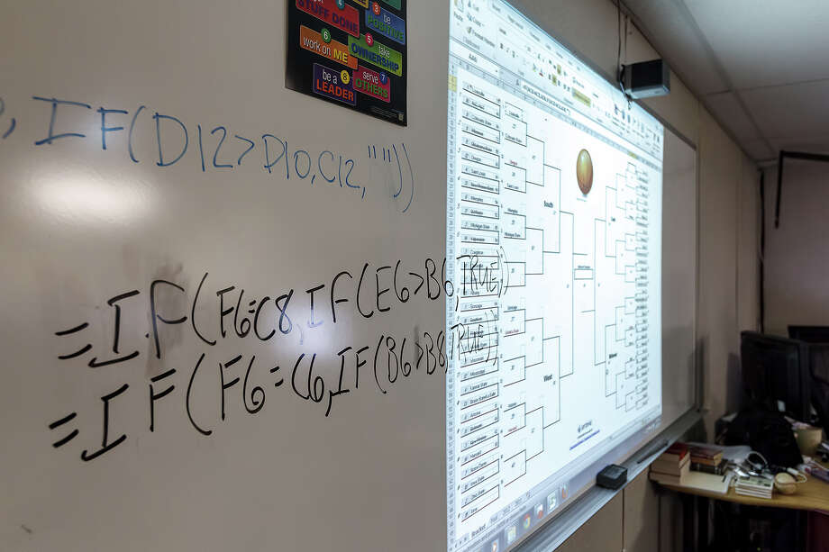 Excel formulas and NCAA bracket displayed on chalkboard in Andrew Eickstead's technology class at Lutheran High School of San Antonio on Friday, March 22, 2013..  Freshmen in Eickstead's class are learning conditional logic using excel spreadsheets and formulas to chart the 2013 NCAA mens basketball tournament.  Photo by Marvin Pfeiffer / Prime Time Newspapers Photo: Marvin G. Pfeiffer Jr. / Copyright 2013 Marvin G. Pfeiffer, Jr.