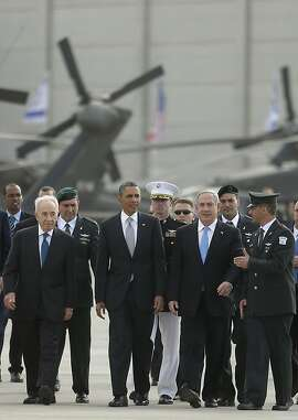 President Barack Obama walks with Israeli Benjamin Netanyau, right, and Israeli President Shimon Peres, left, walk across the tarmac prior to his departure from Ben Gurion International Airport in Tel Aviv, Israel, Friday, March 22, 2013, (AP Photo/Pablo Martinez Monsivais)