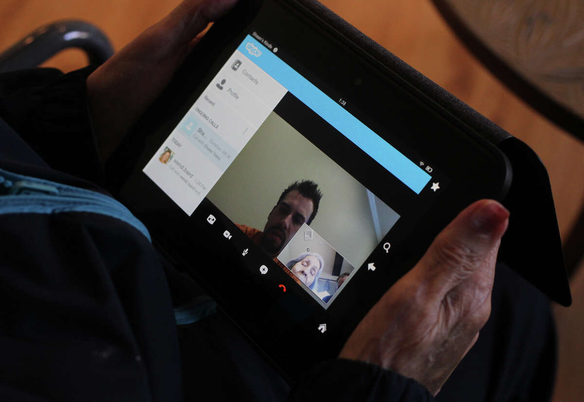 Bertha Cavazos, a resident at Las Colinas of Westover Rehabilitation, uses a Kindle Fire HD to communicate with staff and relatives that are not on the premises. The facility also has Apple TV and has digitized all of its medical record keeping.