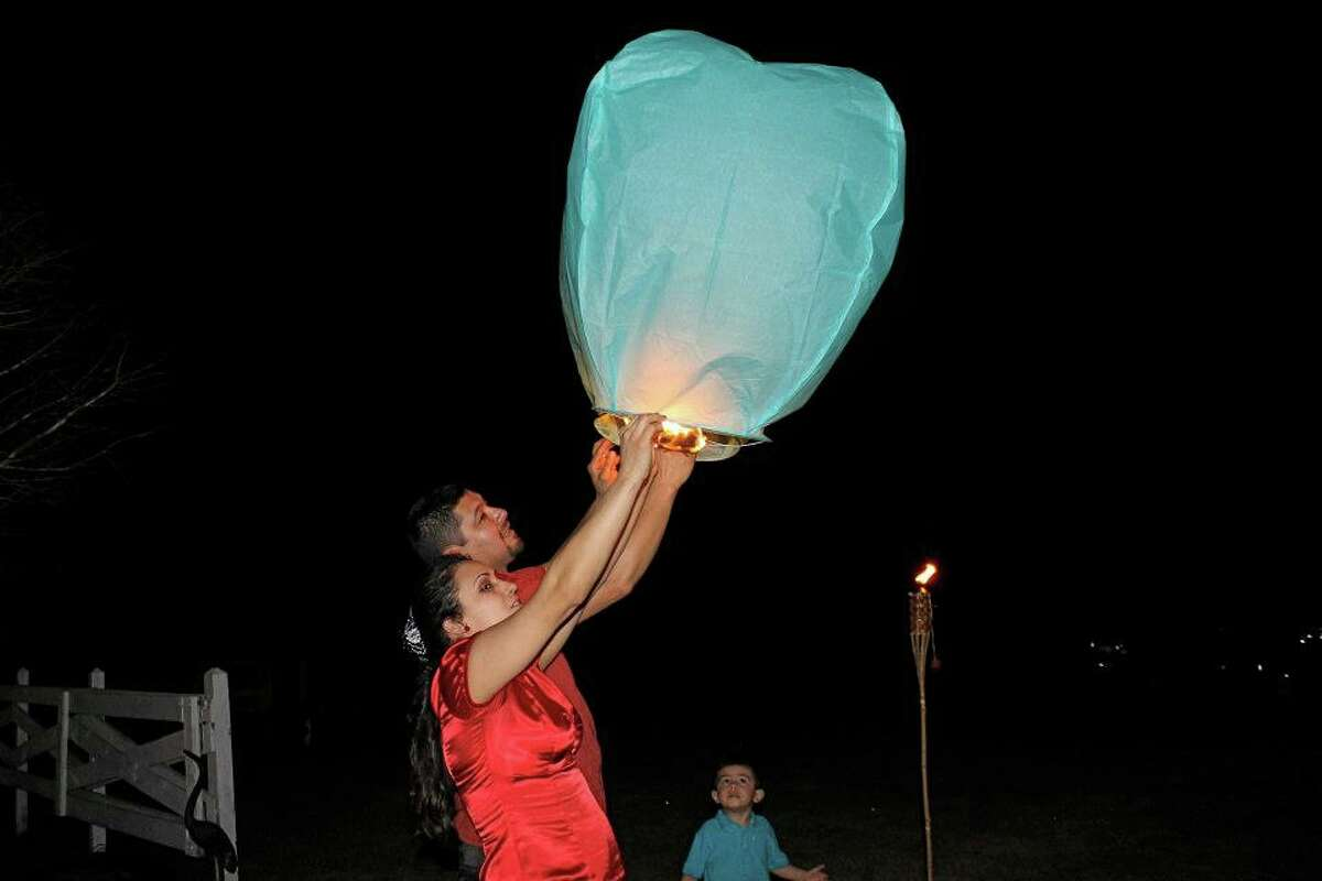 """The mysterious lights that had nervous sky-watchers dialing 911 on Saturday night came not from Mars or Venus, but from """"wish lanterns"""" released during a wedding celebration on the east side of Liberty County."""