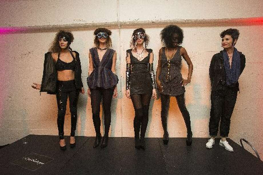 A group of models wearing outfits by Leathertongue stand on stage during fashion collective Underground Fashion Week's fashion show.