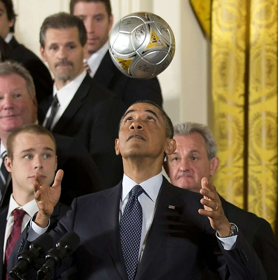Header of the Free World: President Obama heads a soccer ball during a White House ceremony honoring Major League Soccer champion LA Galaxy and the Stanley Cup-winning Los Angeles Kings. He declined to throw his body in front of a slapshot, however. Photo: Manuel Balce Ceneta, Associated Press
