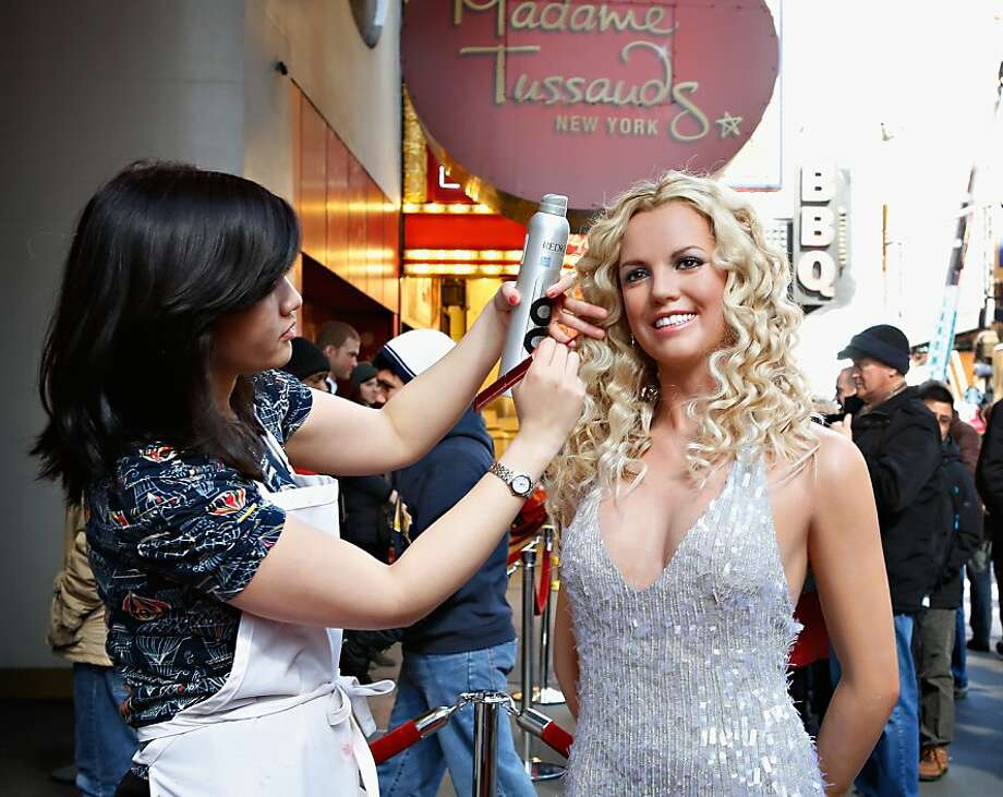 Deceiving diva: The Britney Spears standing outside Madame Tussands in New York is, of course, made out of wax. Otherwise there would be about three dozen paparazzi harassing her. Photo: Cindy Ord, Getty Images For Madam Tussauds