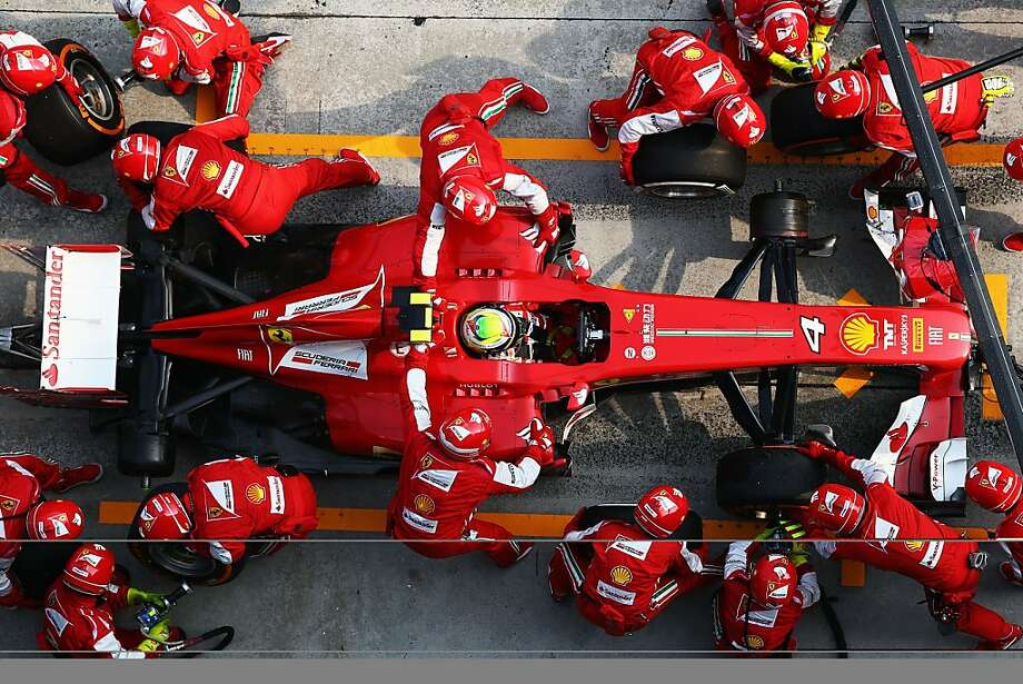 Refill and tire change in an instant: Ferrari racer Felipe Massa of Brazil takes a pitstop during the Malaysian Formula One Grand Prix at the Sepang Circuit in Kuala Lumpur. Photo: Paul Gilham, Getty Images