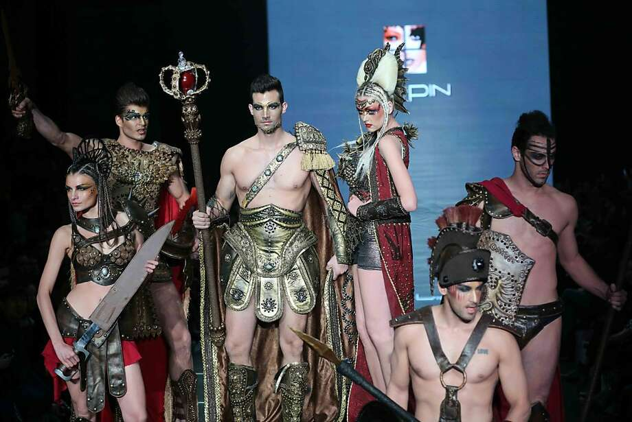 """Thumbs up or down?Nice of the cast of """"Gladiator"""" to show up for Beijing Fashion Week. Photo: Afp, Getty Images"""