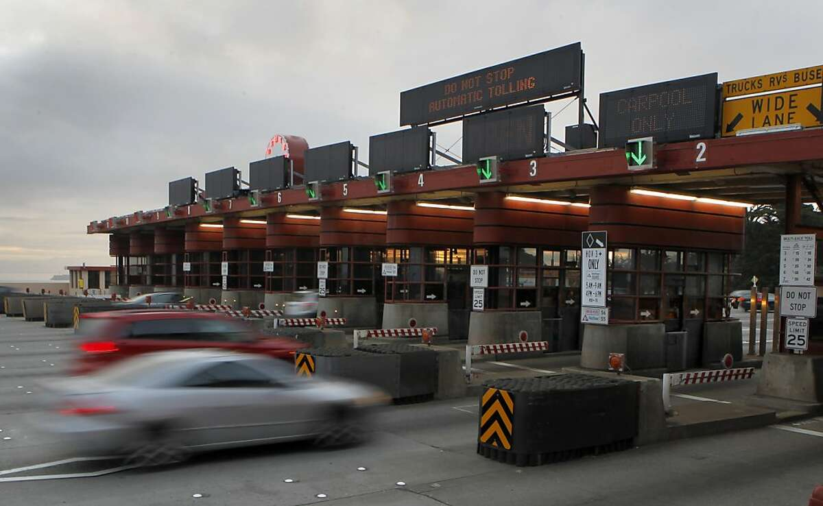 Commuters roll through the toll plaza without stopping on the first day of electronic toll collecting at the Golden Gate Bridge in San Francisco, Calif. on Wednesday, March 27, 2013.