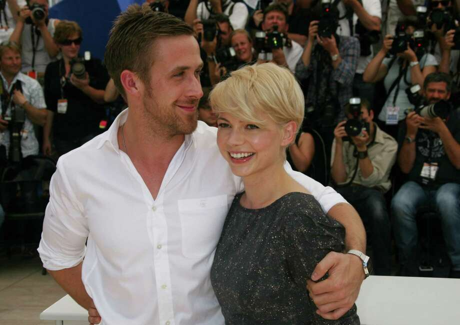 Ryan Gosling gives his familiar one-shouldered squeeze to Michelle Williams while promoting their movie Blue Valentine in Cannes on May 18, 2010. Photo: LOIC VENANCE, AFP/Getty Images / 2010 AFP