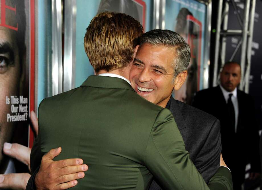 Hugging it out with George Clooney, at The Ides of March premiere on Sept. 27, 2011. Photo: Kevin Winter, Getty Images / 2011 Getty Images