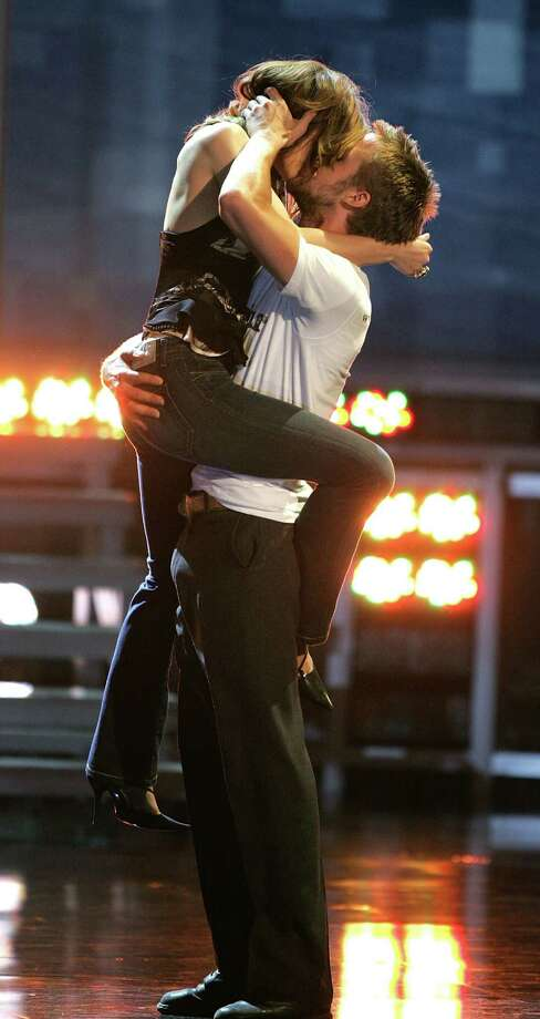 No stranger to PDAs, Ryan Gosling accepts the 2005 MTV movie award for Best Kiss with Rachel McAdams at the Shrine Auditorium in Los Angeles. Photo: Kevin Winter, Getty Images / 2005 Getty Images