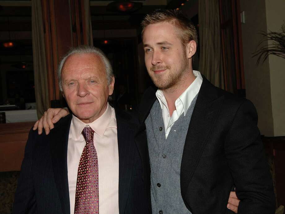 An equal-opportunity hugger, Ryan Gosling is affectionate with old people (Anthony Hopkins at the 2008 Fracture premiere) Photo: Stephen Shugerman, Getty Images / 2007 Getty Images