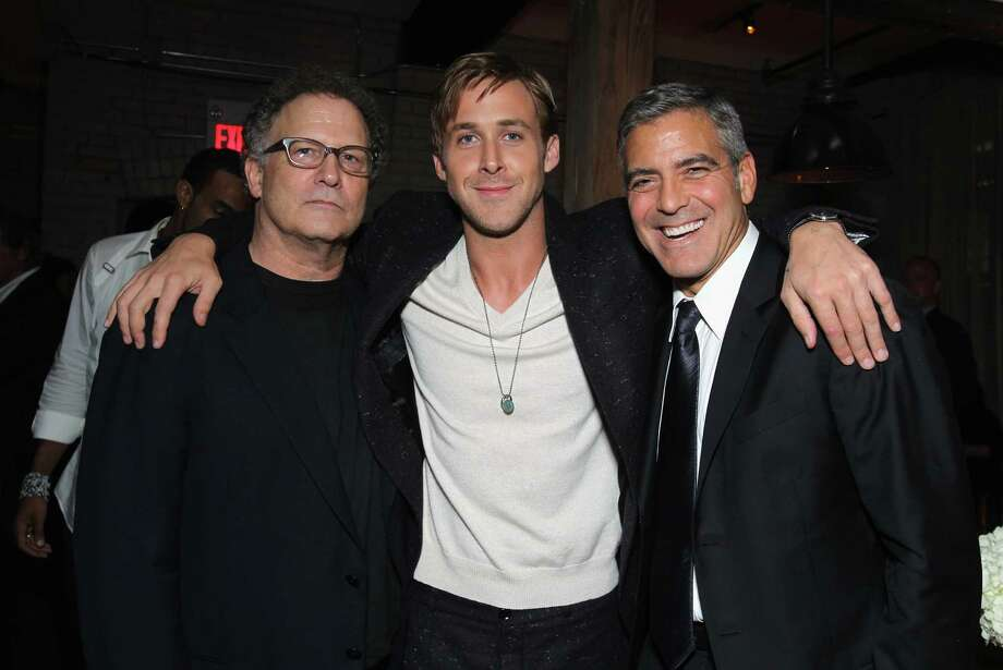 Then there's the triple hug (with Albert Brooks, left, and George Clooney, right, at a party for A Dangerous Method in 2011) Photo: Alexandra Wyman, Getty Images For GREY GOOSE Vodk / 2011 Getty Images