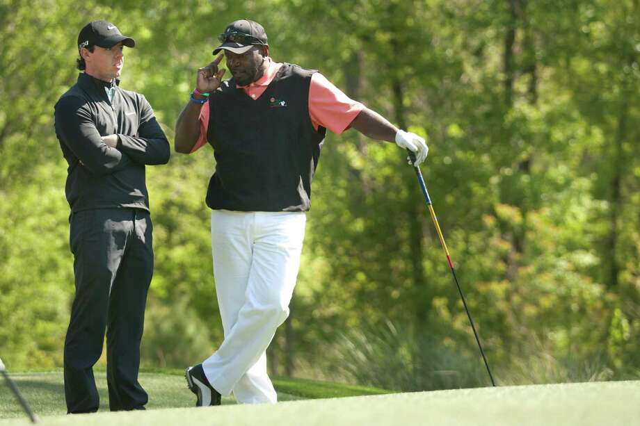Rory McIlroy and Emmitt Smith talk on the No. 2 tee box during the Shell Houston Open Grand Pro-Am at Redstone Tournament Course Wednesday, March 27, 2013, in Houston. Photo: Brett Coomer, Houston Chronicle / © 2013 Houston Chronicle
