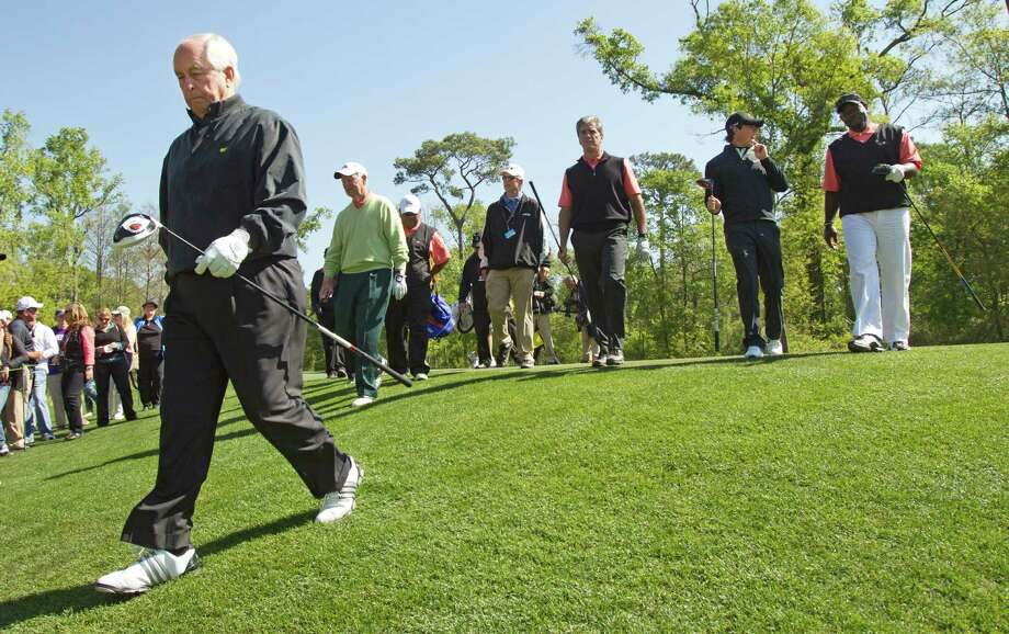 Roger Penske, left, walks of the No. 2 tee box, followed by James A. Baker III, Marvin Odum, Rory McIlroy and Emmitt Smith during the Shell Houston Open Grand Pro-Am at Redstone Tournament Course Wednesday, March 27, 2013, in Houston. Photo: Brett Coomer, Houston Chronicle / © 2013 Houston Chronicle