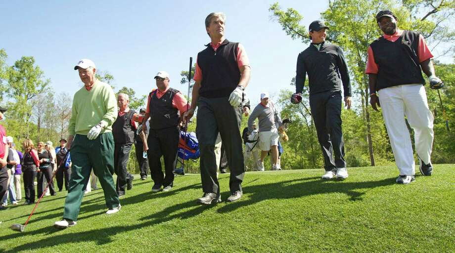 James A. Baker III, left, Marvin Odum, Rory McIlroy and Emmitt Smith walk off the No. 2 tee box during the Shell Houston Open Grand Pro-Am at Redstone Tournament Course Wednesday, March 27, 2013, in Houston. Photo: Brett Coomer, Houston Chronicle / © 2013 Houston Chronicle