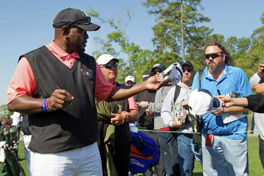 Former Dallas Cowboys running back Emmitt Smith signs autographs as he walks to the first tee for the Shell Houston Open Grand Pro-Am at Redstone Tournament Course Wednesday, March 27, 2013, in Houston. Photo: Brett Coomer, Houston Chronicle / © 2013 Houston Chronicle