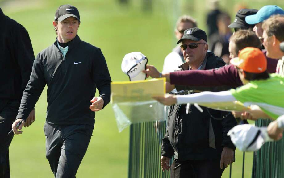 Rory McIlroy walks past autograph-seeking fans as he walks to the first tee for the Shell Houston Open Grand Pro-Am at Redstone Tournament Course Wednesday, March 27, 2013, in Houston. Photo: Brett Coomer, Houston Chronicle / © 2013 Houston Chronicle