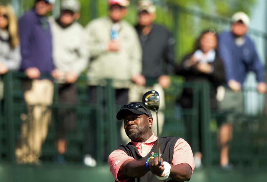 Emmitt Smith, former Dallas Cowboys running back watches his tee shot on No. 1 during the Shell Houston Open Grand Pro-Am at Redstone Tournament Course Wednesday, March 27, 2013, in Houston. Photo: Brett Coomer, Houston Chronicle / © 2013 Houston Chronicle